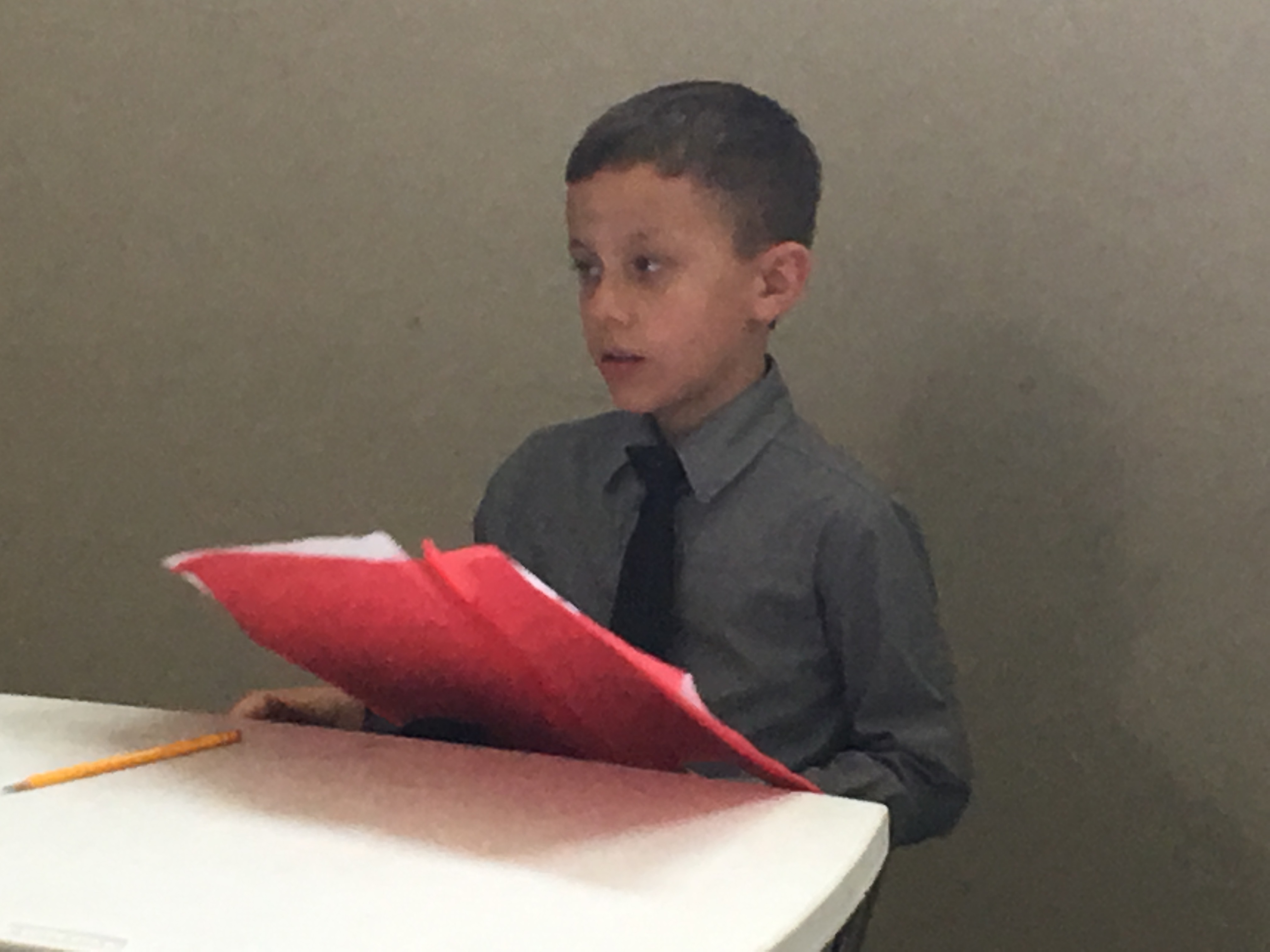 Giving an oral report.